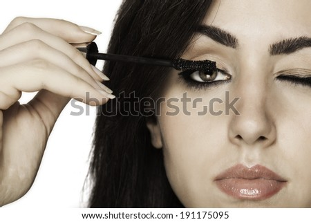 Closeup of beautiful girl putting make up on