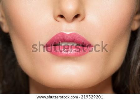 Closeup of beautiful lips with pink lipstick  - stock photo