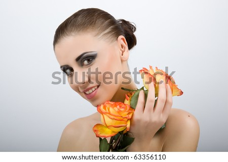 Closeup of beautiful sexy woman with flower