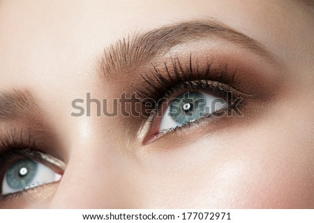 Closeup of beautiful woman eye with bright stylish makeup  - stock photo