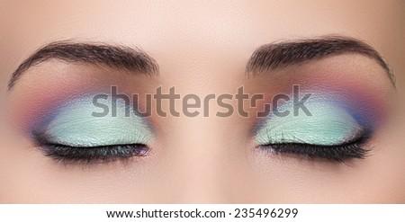 Closeup of beautiful woman eye with makeup, closed eyes  - stock photo
