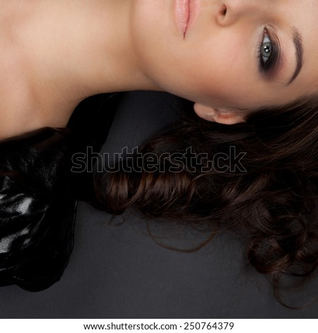 Closeup of beautiful woman with smoky-eyes - stock photo