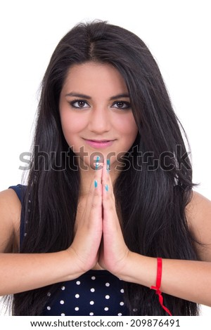 Closeup of beautiful young smiling girl doing yoga salutation - stock photo