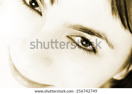 Closeup of beautiful young woman face.