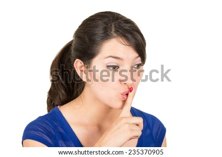 closeup of beautiful young woman gesturing silence shhh with finger on mouth isolated on white - stock photo