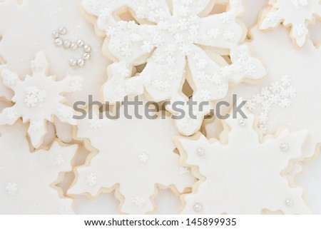 Closeup of beautifully decorated snowflake sugar cookies - stock photo