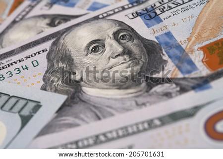 Closeup of Benjamin Franklin on One Hundred Dollar Bill / studio photography of American moneys of hundred dollar  - stock photo