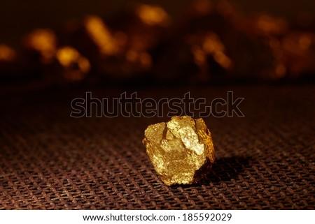 Closeup of big gold nugget - stock photo