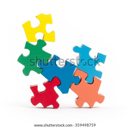 Closeup of big jigsaw puzzle pieces isolated on white - stock photo