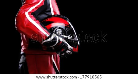 closeup of biker holding helmet side view - stock photo