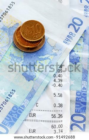 closeup of bills and euro banknotes and coins macro - stock photo
