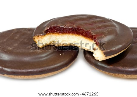 Closeup of bitten chocolate cookie with jam filling. - stock photo