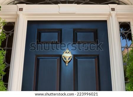 Closeup of Black Front Door and Doorknocker - stock photo