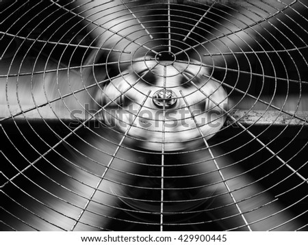 Closeup of black HVAC (Heating, Ventilation and Air Conditioning) spinning blades. Industrial ventilation fan background. - stock photo