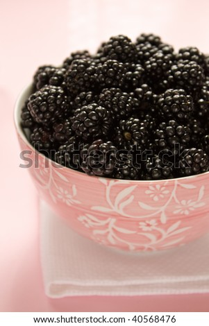 Closeup of blackberries in a pink bowl - stock photo