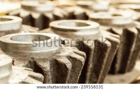 Closeup of blank interconnected industrial metal gears - stock photo