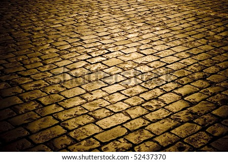 Closeup of block pavement in the darkness (as a background) - stock photo