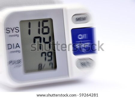 Closeup of blood pressure monitor showing recent reading - stock photo