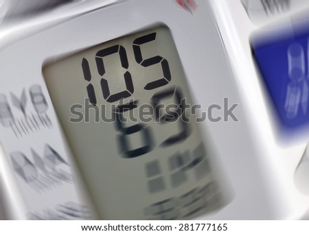 Closeup of blood pressure monitor with spin effect - stock photo