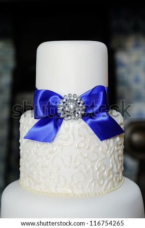 Closeup of blue and white wedding cake at reception - stock photo