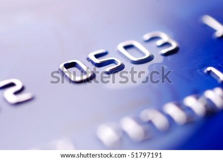 closeup of blue credit card - stock photo