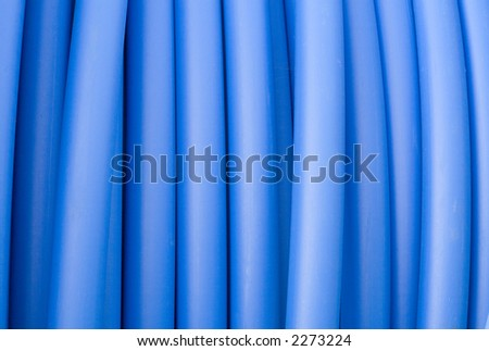 Closeup of blue electricity cable of pipeline.