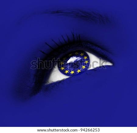 closeup of blue eye with european union flag - stock photo