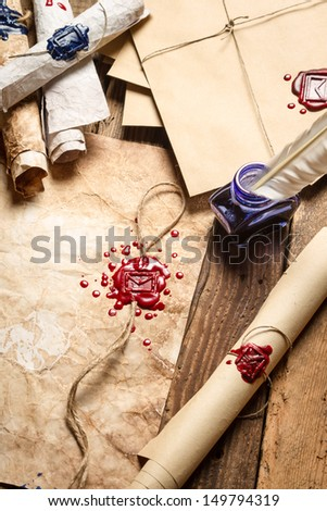 Closeup of blue ink and vintage envelope - stock photo