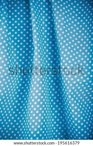 closeup of blue polka dot fabric - stock photo