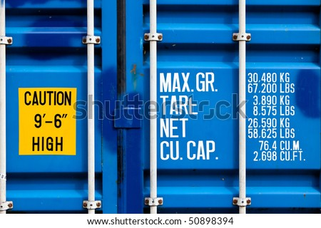 closeup of blue shipping container with white lettering - stock photo