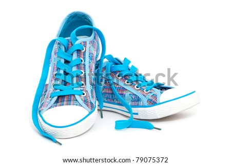Closeup of blue sneakers with shoelaces isolated on white background - stock photo
