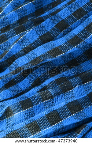 Closeup of blue tartan fabric - stock photo