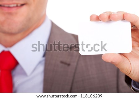 Closeup of blurred business man holding a blank business card on focus - stock photo