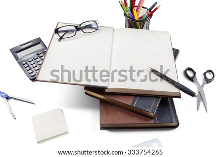 Closeup of books with blank page and school supplies on white background