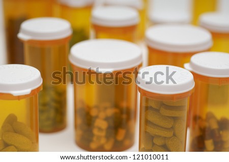 Closeup of bottles of pills - stock photo