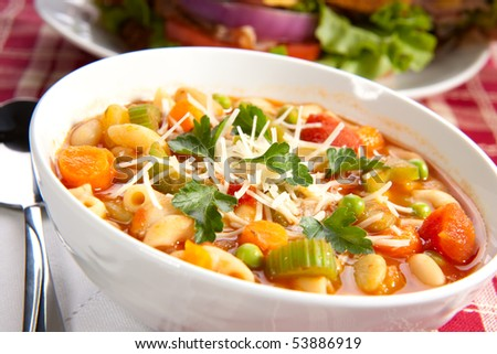 Closeup of bowl of hot fresh Minestrone soup - stock photo