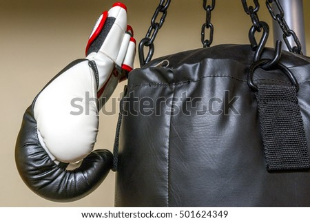 Closeup of boxing glove hanging on heavy bag