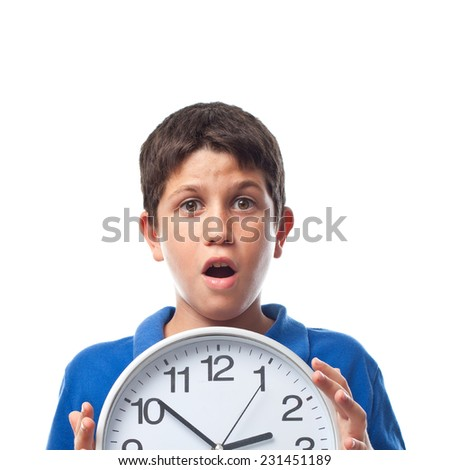 closeup of boy with a clock - stock photo
