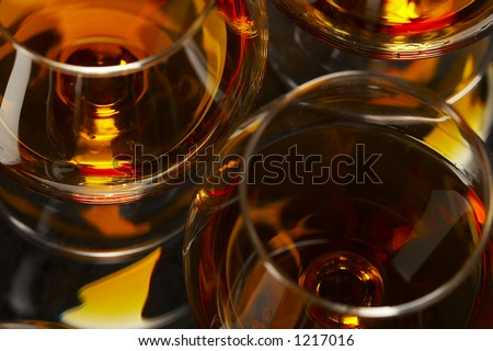 closeup of brandy glasses with alcohol