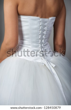 Closeup of bridal gown with corset back - stock photo