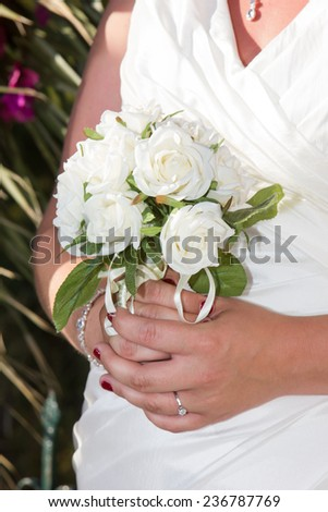 closeup of bride holding a bouquet of beautiful flowers