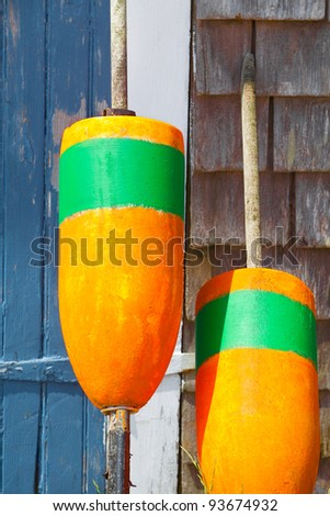 Closeup of bright orange fishing buoys - stock photo