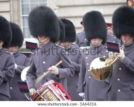 closeup of British guards, banging on the drums - stock photo