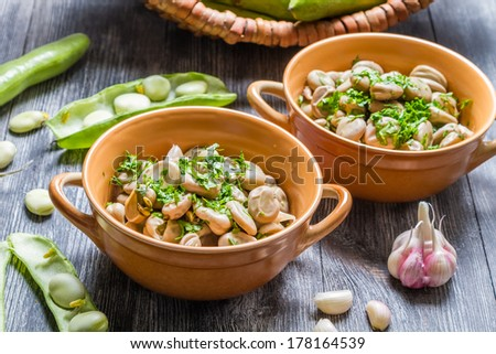 Closeup of broad beans with parsley and garlic - stock photo