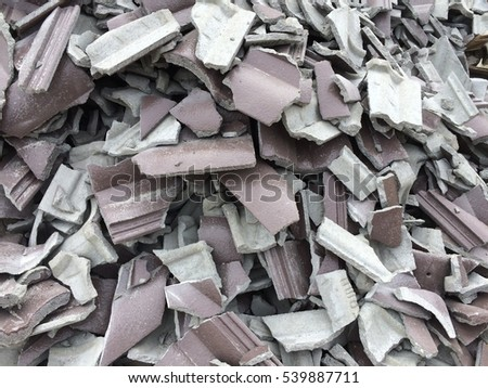 Closeup of broke roof roof tile gray shingles , background , textures