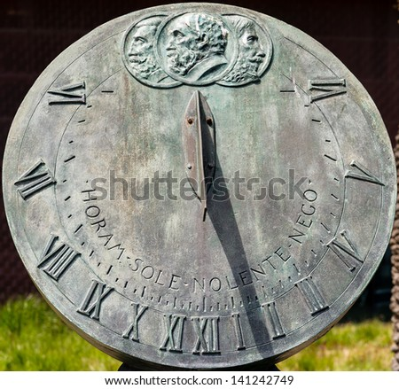 Closeup of bronze sundial - stock photo