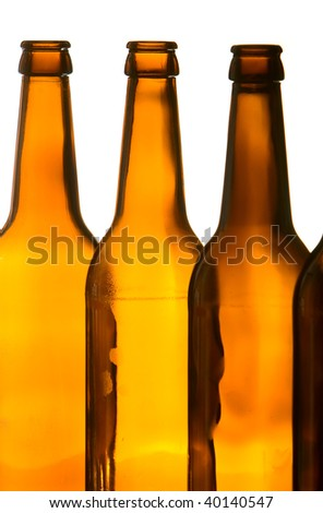 Closeup of brown beer bottles. Backlit, studio shot. Isolated on white. - stock photo