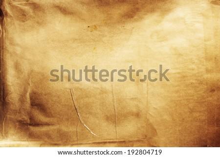 Closeup of brown grunge paper texture - stock photo