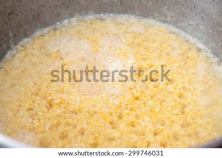 Closeup of bulgur under water with selective focus - stock photo