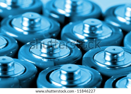 Closeup of bunch of AA batteries - stock photo